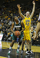 January 27 2010: Michigan St. forward Lykendra Johnson (30) eyes the basket as Iowa center Morgan Johnson (12) defends during the second half of an NCAA women's college basketball game at Carver-Hawkeye Arena in Iowa City, Iowa on January 27, 2010. Iowa defeated Michigan State 66-64.