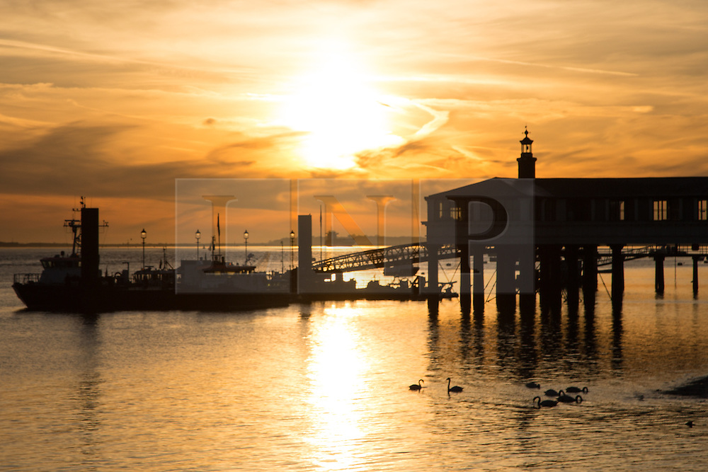 © Licensed to London News Pictures. 14/04/2015. Sun rises over Royal Terrace Pier in Gravesend, home of the Port of London Authority. Tuesday 14th April got started with a deep Turneresque sky over the Thames estuary. Several days of good weather are predicted and Gravesend is often the location where the highest temperatures are recorded. Credit : Rob Powell/LNP