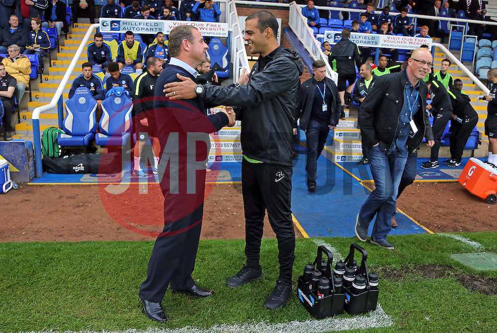 Peterborough United Manager Dave Robertson shakes hands with Charlton Athletic Manager Guy Luzon before kick-off - Mandatory byline: Joe Dent/JMP - 07966386802 - 25/08/2015 - FOOTBALL - ABAX Stadium -Peterborough,England - Peterborough United v Charlton Athletic - Capital One Cup - Second Round