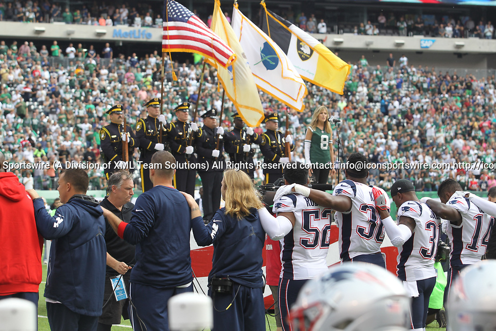 EAST RUTHERFORD, NJ - OCTOBER 15: Patriot players stand arm in arm during the National anthem prior to the start of a regular season NFL game between the New England Patriots and the New York Jets on October 15, 2017, at MetLife Stadium in East Rutherford, NJ. (Photo by David Hahn/Icon Sportswire)