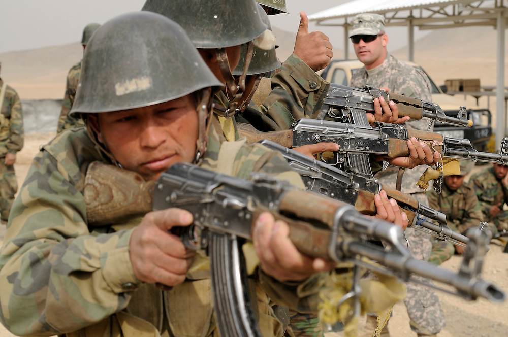 Afghan National Army recruits practice urban warfare training at the KMTC (Kabul Military Traning Center) with mentoring by American and other coalition trainers.  Most training is done by officers in the Afghan Army.