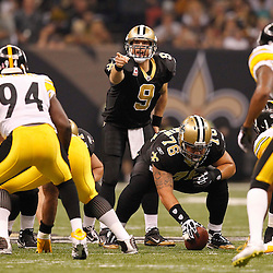 Oct 31, 2010; New Orleans, LA, USA; New Orleans Saints quarterback Drew Brees (9) under center during the first half against the Pittsburgh Steelers at the Louisiana Superdome. Mandatory Credit: Derick E. Hingle..