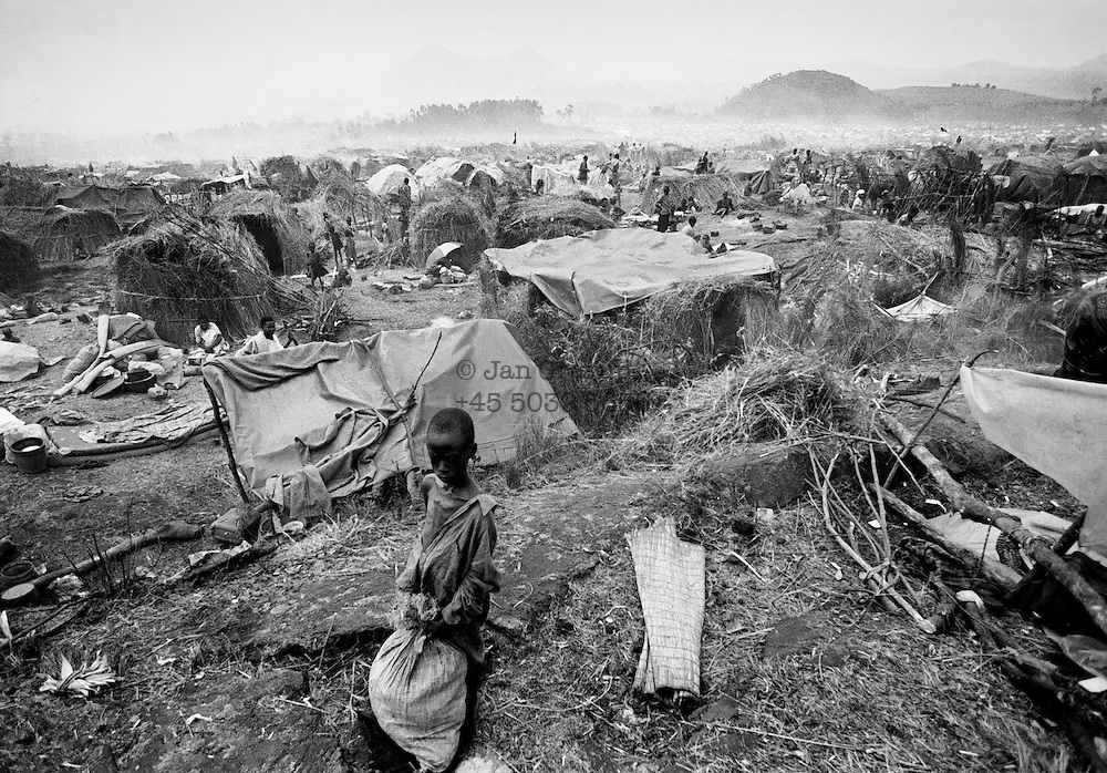 A newly arrived refugee at the  camp outside Goma, Zaire, both his parents was killed during the genocide in Rwanda. 1994 - <br /> The sun had set over the rwandan capital Kigali as president Juvenal Habyarimana's plane approached the city's airport on 6.april 1994.Suddenly, out of the darkness, a rocket hit the plane and sent it crashing to the ground, killing everyone on board.over the next three month's, more than 800.000 rwandans would be murdered, many cut down with machetes, killed by neighbours and countrymen, in a ferocious ethnic genocide that was all but ignored by the international world.