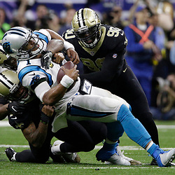 Jan 7, 2018; New Orleans, LA, USA; New Orleans Saints defensive end Cameron Jordan (94) and free safety Vonn Bell (48) and defensive end George Johnson (90) combine to sack Carolina Panthers quarterback Cam Newton (1) during the fourth quarter in the NFC Wild Card playoff football game at Mercedes-Benz Superdome. Mandatory Credit: Derick E. Hingle-USA TODAY Sports