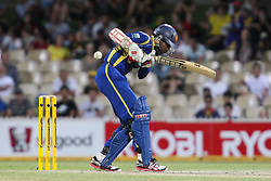 © Licensed to London News Pictures. 08/03/2012. Adelaide Oval, Australia. .Upul Tharanga gets hit in the chest after facing a fast delivery from Brett Lee during the One Day International cricket match final between Australia Vs Sri Lanka. Photo credit : Asanka Brendon Ratnayake/LNP