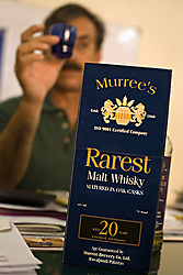 Major Sabih-ur-Rehman, special assistant to the CEO, has a shot of the company's 12-year-old single malt whiskey, Rawalpindi, Pakistan, Sept. 12, 2007. The almost 150 year old company is preparing to bring the Muslim world's first 20 year old single malt whisky to the market. However, they can only sell to non-Muslims, who comprise 3 percent of Pakistan's population.