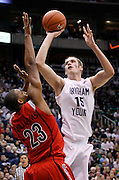 Brigham Young Cougars center James Anderson (15) attempts to score over the defense of Arizona Wildcats forward Derrick Williams (23) during the first half of an NCAA basketball game, Dec. 11, 2010 in Salt Lake City. (AP Photo/Colin E Braley)