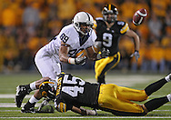 October 2 2010: Penn State Nittany Lions tight end Garry Gilliam (89) can't pull in a pass as he is hit by Iowa Hawkeyes linebacker Tyler Nielsen (45) during the first half of the NCAA football game between the Penn State Nittany Lions and the Iowa Hawkeyes at Kinnick Stadium in Iowa City, Iowa on Saturday October 2, 2010. Iowa defeated Penn State 24-3.