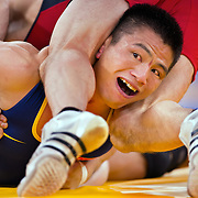 Shujin Li of China, right, looked for an esacpe from a move by Aleksandar Stoyanov Kostadinov of Bulgaria, top, in the 1/8 final of the 55kg Greco-Roman wrestling match at the ExCeL centre during the 2012 Summer Olympic Games in London, England, Sunday, August 5, 2012. (Li ended up winning, 3-1, to advance to the quarterfinals. David Eulitt/Kansas City Star/MCT)