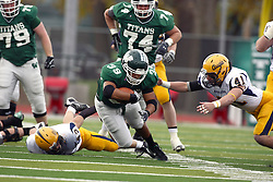 12 November 2011:  Sean Conley is impeded by the reach of Mike McLean during an NCAA division 3 football game between the Augustana Vikings and the Illinois Wesleyan Titans in Tucci Stadium on Wilder Field, Bloomington IL