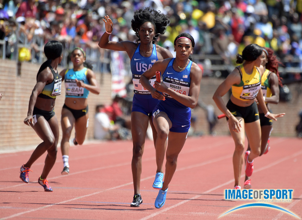 Apr 28, 2018; Philadelphia, PA, USA; Raeven Rogers takes the handoff from Kimberlyn Duncan on the 400m anchor leg on the USA Red women's sprint medley relay that won in a world-record 1:35.20 during the 124th Penn Relays at Franklin Field.