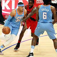 18 March 2018: LA Clippers forward Tobias Harris (34) drives past Portland Trail Blazers forward Al-Farouq Aminu (8) on a screen set by LA Clippers center DeAndre Jordan (6) during the Portland Trail Blazers 122-109 victory over the LA Clippers, at the Staples Center, Los Angeles, California, USA.