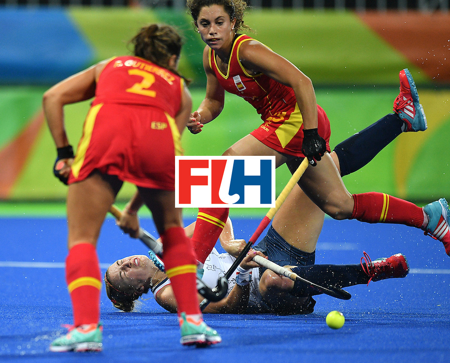 Spain's Gigi Oliva vies with Britain's Lily Owsley (bottom) during the women's quarterfinal field hockey Britain vs Spain match of the Rio 2016 Olympics Games at the Olympic Hockey Centre in Rio de Janeiro on August 15, 2016. / AFP / Carl DE SOUZA        (Photo credit should read CARL DE SOUZA/AFP/Getty Images)