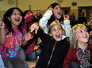 Joe Romano, the reading magician, has these Baltimore Highlands Elementary School students totally enchanted by his antics.  The enthusiastic audience members are Gabriella Rivera-Zavala (left), Joselyne Flores, Lana Deshner (front left) and Austin Chamberlain.