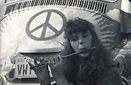 A teen age girl plays a flute while dress as a hippie during homecoming week in 1989.