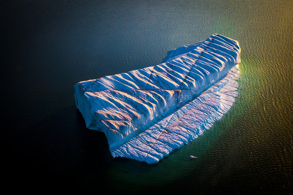 "Aerial photo of crenellated - or corrugated iceberg, drifting near Humboldt Glacier, Greenland. Humbolt glacier is the widest glacier, at 110km, in the northern hemisphere. This mage can be licensed via Millennium Images. Contact me for more details, or email mail@milim.com For prints, contact me, or click ""add to cart"" to some standard print options."