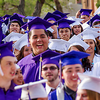 051513       Cable Hoover<br /> <br /> Miyamura High School senior Bronson Mitchell cheers as he lines up with his fellow graduates during the Miyamura High School graduation ceremony at Public School Stadium in Gallup Wednesday.
