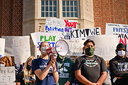 07 SEPTEMBER 2020 - DES MOINES, IOWA: TABITHA KEITH, a Roosevelt High School volleyball player, leads a rally at Roosevelt High School. About 300 Des Moines Public School (DMPS) high school athletes marched through Des Moines to the Governor's Mansion Monday to protest Gov. Kim Reynolds' recent efforts to reopen schools. DMPS, the largest school district in Iowa, is suing to go to online instruction because of the COVID-19 pandemic. The Governor is trying to force the district to reopen with in person instruction. The state ruled that schools using online education can't participate in extracurricular activities, including sports. The student athletes, who all wore face masks to comply with CDC guidelines, were marching to demand the ability to participate in sports despite using online instruction.     PHOTO BY JACK KURTZ