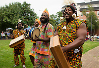 The Akwaaba Ensemble Abou Sylla, Mary Sosu, Theo Martey and David Nyadedzor performing traditional Ghanian drum and dance for the crowd gathered at Rotary Park during Laconia's Multicultural Festival on Saturday.  (Karen Bobotas/for the Laconia Daily Sun)