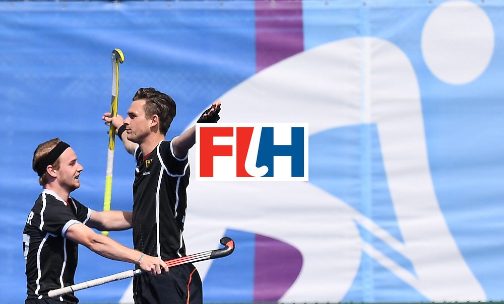 Germany's Christopher Wesley (R) celebrates scoring a goal during the men's field hockey Argentina vs Germany match of the Rio 2016 Olympics Games at the Olympic Hockey Centre in Rio de Janeiro on August, 11 2016. / AFP / MANAN VATSYAYANA        (Photo credit should read MANAN VATSYAYANA/AFP/Getty Images)