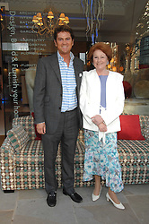 RUPERT LUND and LADY ELIZABETH ANSON at the launch of The Rupert Lund Showroom, 61 Chelsea Manor Street, London SW3 on 2nd May 2007.<br />
