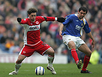 Photo: Lee Earle.<br /> Portsmouth v Middlesbrough. The Barclays Premiership. 15/04/2006. Boro's Fabio Rochemback (L) holds off Svetoslav Todorov.