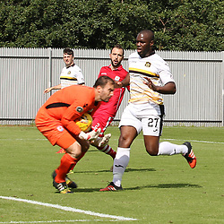 John Danby gets there before Christian Nade during the Dumbarton v Connah's Quay Nomads Irn Bru cup second round 2 September 2017<br /> <br /> <br /> <br /> <br /> (c) Andy Scott | SportPix.org.uk