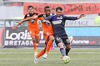 Jordan AYEW / Pavle NINKOV - 18.04.2015 - Lorient / Toulouse - 33eme journee de Ligue 1<br />Photo : Vincent Michel / Icon Sport