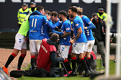 Rangers' Andy Halliday (centre, hidden) celebrates scoring his side's first goal of the game with team-mates during the Scottish Premiership match at Dens Park, Dundee.