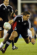New Zealand's Nigel Hunt attacks during the rugby sevens match against Kenya at the Telstra Dome on day one of the XVIII Commonwealth Games in Melbourne, Australia, on Thursday 16 March 2006. Photo: Sport the Library / www.photosport.nz