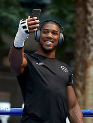 Anthony Joshua takes a selfie during the public work-out at the Brookfield Place, New York.