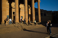 On thew steps of the NSW Art Gallery in late afternoon light in Sydney's inner city area called The Domain.