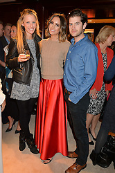 Left to right, KATE FREUD, LOUISE ROE and JACK FREUD at a party to celebrate the publication of Front Roe by Louise Roe held at Ralph Lauren, 1 New Bond Street, London on 1st April 2015.