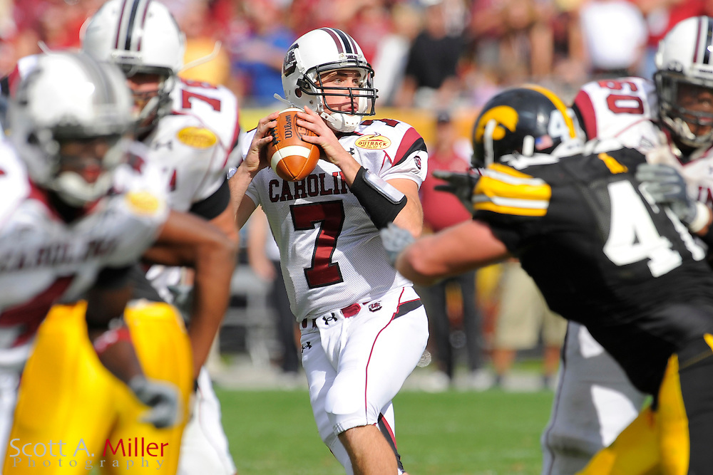 Jan 1, 2009; Tampa, FL, USA; South Carolina Gamecocks quarterback Chris Smelley (7) looks upfield during his team's 31-10 loss to the Iowa Hawkeyes in the Outback Bowl at the Raymond James Stadium ©2009 Scott A. Miller