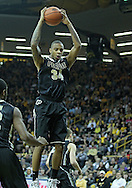 December 28, 2011: Purdue Boilermakers forward Jacob Lawson (34) pulls down a rebound during the NCAA basketball game between the Purdue Boilermakers and the Iowa Hawkeyes at Carver-Hawkeye Arena in Iowa City, Iowa on Wednesday, December 28, 2011. Purdue defeated Iowa 79-76.