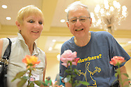 MOUNT LAUREL, NJ - JULY 26: Audrey Osborn of Cape Cod, Massachusetts and Bruce Monroe of Wilmington, Delaware view roses  during the 2014 National Miniature Rose Show, hosted by the West Jersey Rose Society at the Hotel ML  July 26, 2014 in Mount Laurel, New Jersey. (Photo by William Thomas Cain/Cain Images)