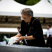 NAGASAKI, JAPAN - AUGUST 9 : A woman offer water and pray for the atomic bomb victims in front of the Nagasaki Peace Park in Nagasaki, southern Japan, Tuesday, August 9, 2016. Japan marked the 71st anniversary of the atomic bombing on Nagasaki. On August 9, 1945, during World War II, the United States dropped the second Atomic bomb on Nagasaki city, killing an estimated 40,000 people which ended World War II. (Photo by Richard Atrero de Guzman/NURPhoto)