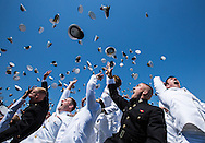 Graduates from the Class of 2015 toss their academy covers into the air at the conclusion of the Graduation/Commissioning Ceremony at the United States Naval Academy on Friday May 22, 2015. (Alan Lessig/Staff)