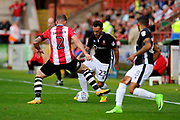 Neal Eardley (23) of Lincoln City battles for possession with Pierce Sweeney (2) of Exeter City during the EFL Sky Bet League 2 match between Exeter City and Lincoln City at St James' Park, Exeter, England on 19 August 2017. Photo by Graham Hunt.