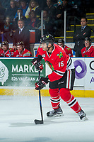 KELOWNA, CANADA - APRIL 8: Shaun Dosanjh #15 of the Portland Winterhawks passes the puck against the Kelowna Rockets on April 8, 2017 at Prospera Place in Kelowna, British Columbia, Canada.  (Photo by Marissa Baecker/Shoot the Breeze)  *** Local Caption ***