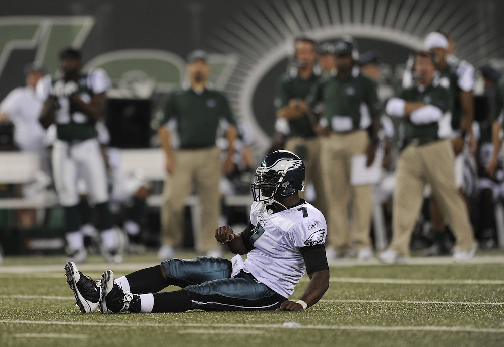 EAST RUTHERFORD, NJ - SEPTEMBER 3: Michael Vick #7 of the Philadelphia Eagles is tackled by the New York Jets on September 3, 2009 at Giants Stadium in East Rutherford, New Jersey. The Jets won 38-27. (Photo by Rob Tringali) *** Local Caption *** Michael Vick