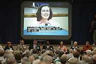 Hillsborough County Commissioner Kathy Castor speaks below a large screen with her image in 2004.  Castor is currently running for a congressional seat.