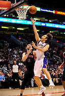 Jan. 24, 2012; Phoenix, AZ, USA; Phoenix Suns guard Steve Nash (13)  puts up a shot against the Toronto Raptors guard Linas Kleiza (11) during the second half at the US Airways Center. The Raptors defeated the Suns 99-96. Mandatory Credit: Jennifer Stewart-US PRESSWIRE..