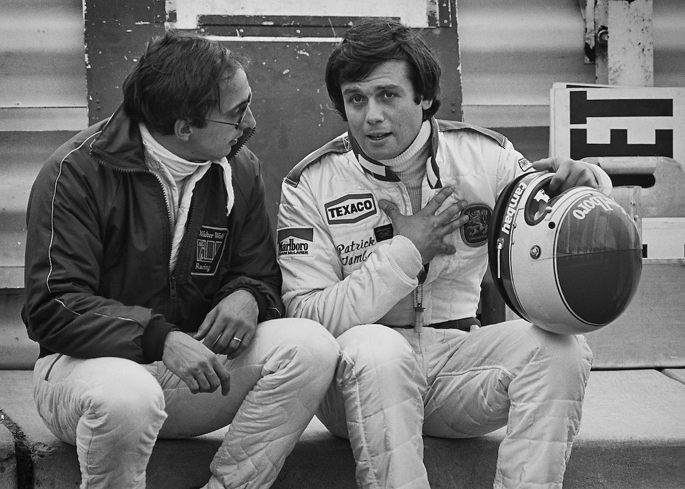 American Wolf-Ford F1 driver Bobby Rahal and France's Marlboro Lowenbrau McLaren-Ford driver Patrick Tambay share stories and advice during a lull in practice for the 1978 United States Grand Prix at Watkins Glen, NY. <br /> <br /> Rahal and Tambay had a friendship that went back to their North American Can-Am series competition as well as their common experiences with Carl Haas Racing, Formula Atlantic and Formula 2. <br /> <br /> When Rahal was given to opportunity to partner with Jody Scheckter as second driver for the Walter Wolf-Ford F1 team during the final two races of the season in Canada and the United Staes, good friend Tambay was there to share, caution and cajole Rahal as to the more delicate aspects of a Formula One car and Formula One life. <br /> <br /> Tambay would go on to finish 6th, while Rahal would finish a commendable 12th.<br /> <br /> One of Three