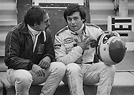 American Wolf-Ford F1 driver Bobby Rahal and France's Marlboro Lowenbrau McLaren-Ford driver Patrick Tambay share stories and advice during a lull in practice for the 1978 United States Grand Prix at Watkins Glen, NY. <br />