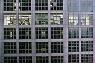 Workers in an office speak in Beijing, China, Monday, Oct. 27, 2008. Block after city block, towers of concrete, steel and glass fill the skyline. .Teeming and congested, the intensely urban landscapes of China's biggest cities show a glimpse of what the future will hold for the rest of the country.In the sprawling megacities of Beijing, Shanghai and Chongqing, where populations exceed 10 million people, extreme urban density means that the number of people living within a few square blocks here is equal to the population of entire mid-size U.S. cities. .China's urban population soared to 607 million people last year _ nearly equaling the 700 million living in the countryside. The country's headlong plunge toward urbanization continues unabated as tens of millions of migrants from the countryside flood to cities in search of money, jobs and other opportunities.