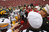 November 25, 2011: The captains of both teams watch the coin toss before the start of the NCAA football game between the Iowa Hawkeyes and the Nebraska Cornhuskers at Memorial Stadium in Lincoln, Nebraska on Friday, November 25, 2011. Nebraska defeated Iowa 20-7.