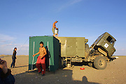 GOBI DESERT, MONGOLIA..08/29/2001.Tzochorinam, gers belonging to the family of wealthy camel herder and local hero Chimiddorj. Portable shower next to kitchen car of Nomads Tours' tent camp..(Photo by Heimo Aga).
