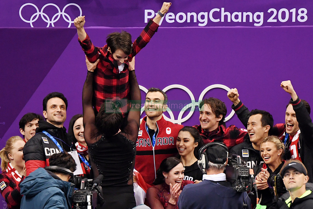 PYEONGCHANG, Feb. 12, 2018  Team Canada celebrate after winning the figure skating team event at the 2018 PyeongChang Winter Olympic Games, in Gangneung Ice Arena, South Korea, on Feb. 12, 2018. Canada won the gold medal with 73 points in total. (Credit Image: © Ju Huanzong/Xinhua via ZUMA Wire)
