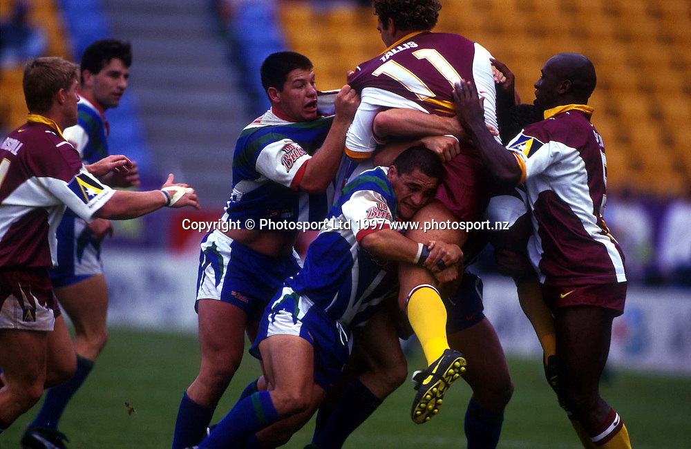 Broncos second rower Gordon Tallis is tackled by Brady Malam and Syd Eru, Super League, Warriors v Brisbane Broncos, 1997. Photo: Andrew Cornaga/PHOTOSPORT